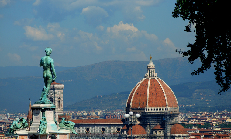"""View from Piazza Michelangelo, Florence. A bronze copy of Michelangelo's David looks out across the city towards the Duomo."""